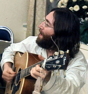 John Lennon rehearses Give Peace a Chance, 1969, copyrighted photo by Roy Kerwood licensed under the Creative Commons Attribution 2.5 Generic License.