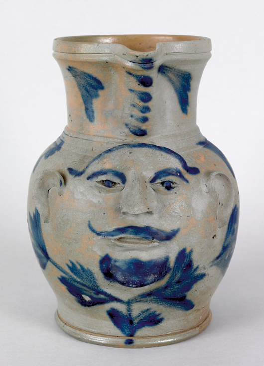 Rare and whimsical, a Philadelphia stoneware face pitcher accented with cobalt sold for $81,900 in October 2008. Courtesy Pook & Pook.