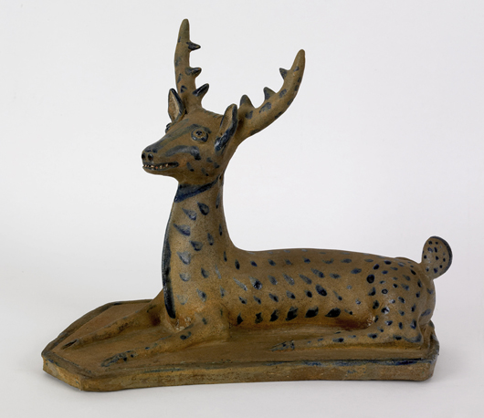Stoneware figural examples are a rare breed. This stag, probably western Pennsylvania, circa 1875, soared to $111,150. Courtesy Pook & Pook.