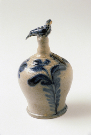 'Crocks, Jugs and Jars: Decorated American Stoneware,' an exhibition at the Brandywine River Museum through July 10, includes examples on loan from public institutions and private collectors. Attributed to Philadelphia maker Richard C. Remmey, this cobalt decorated coin bank, circa 1880-1890, is topped with a fanciful bird finial molded by hand. Image collection of Winterthur Museum.