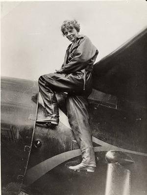 Amelia Earhart mounts her Lockheed Vega 5b circa 1935. Image courtesy of Wikimedia Commons.