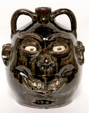 Double face jug by the late renowned folk artist Lanier Meaders. Image courtesy of Slotin Folk Art.