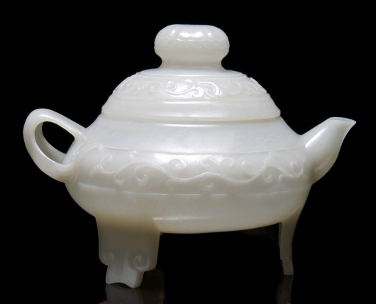 In January, this translucent jade teapot with lotus finial and vines in relief on the sides brought $19,520 at Leslie Hindman's auction in Chicago. Courtesy Leslie Hindman Auctioneers
