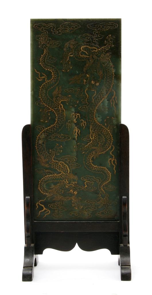 A rectangular plaque of green spinach jade carved with two dragons on either side of a flaming pearl realized $20,740 in Hindman's October 2009 sale. Courtesy Leslie Hindman Auctioneers