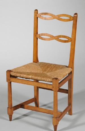 """Val-Kill Industries cherry and maple ribbon-back armchair No. 57 with woven rush seat, branded mark and impressed mark """"57J, FRANK."""" Estimate $300-$500. Image courtesy LiveAuctioneers.com and Skinner Inc."""