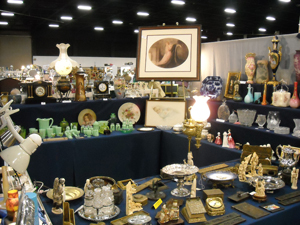 Gladys and John Ezzo's booth at the West Palm Beach Antiques Festival typically displays 400-500 items of art glass, art, jadeite and bronze.