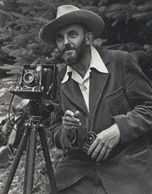 Photo portrait of photographer Ansel Adams that first appeared in the 1950 Yosemite Field School yearbook. Photo by J. Malcolm Greany.