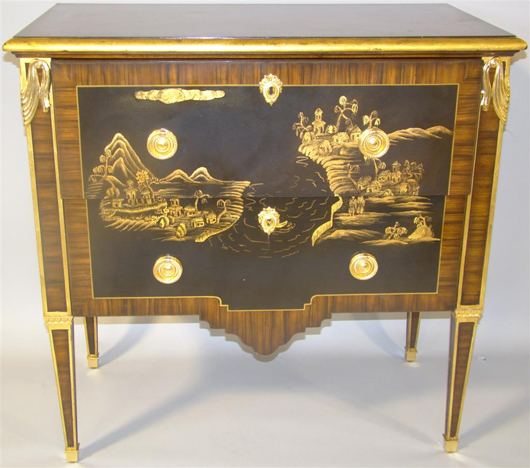 Maitland Smith Louis XVI chinoiserie cabinet, rectangular top over two drawers with black lacquer-style ground with gilt architectural landscape and ormolu mounts, raised on tapering legs. Provenance: J. Brown & Co. Estimate $300-$500. Image courtesy The Potomack Company.
