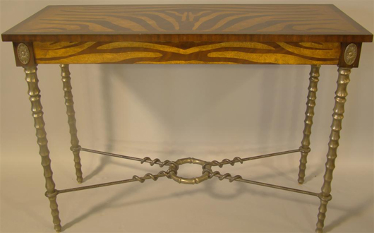 Maitland Smith zebra-pattern painted parson's table with antler-style chrome legs, 34½ x 48 x 19 inches. Provenance: J. Brown & Co. Estimate: $200-$400. Image courtesy The Potomack Company.