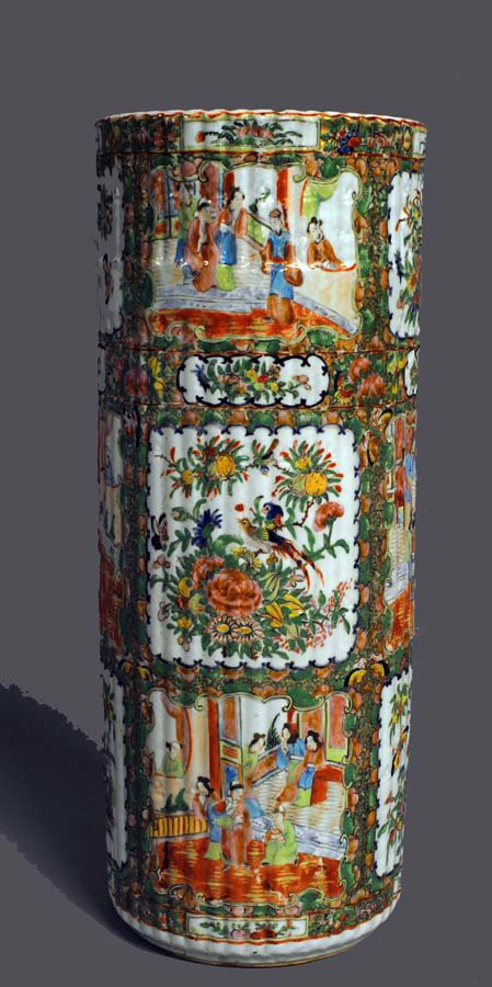 One of the most unusual pieces in the Rose Medallion collection is this 19th-century umbrella stand. The fluted cylindrical vessel is painted with alternating figural and floral panels. It has an $800-$1,200 estimate. Image courtesy of Auction Gallery of the Palm Beaches.