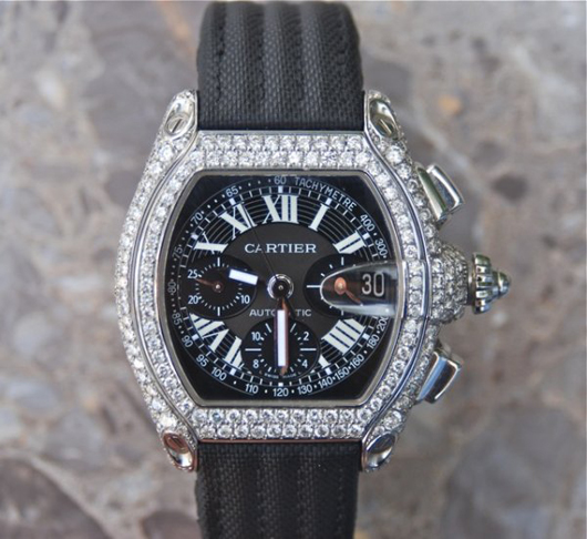 Cartier Roadster Chronograph XL with diamonds, estimate $12,000-$16,000. Image courtesy of LiveAuctioneers.com and J. Sugarman Auction Corp.