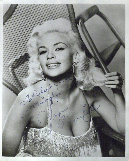 Jayne Mansfield, one of Hollywood's platinum-blonde sex symbols of the 1950s, inscribed this black and white photograph to a fan. The autographed 8-by-10 enlargement has a $500-$800 estimate. Image courtesy of The Written Word Autographs.