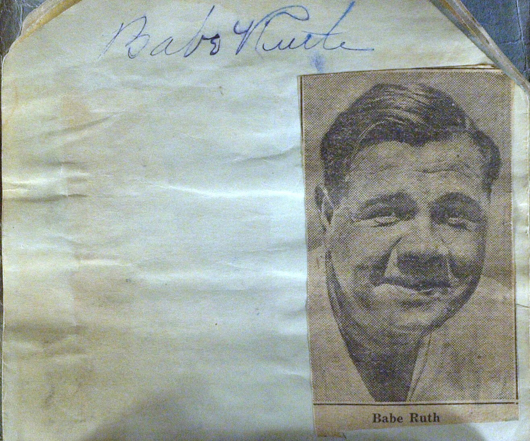 Babe Ruth, baseball's first great slugger and the most celebrated athlete of his time, signed a fan's album page. A small newspaper photograph of Ruth has been affixed beneath the signature. The 4 1/2-inch by 5-inch page has an estimate of $2,500-$3,800. Image courtesy of The Written Word Autographs.