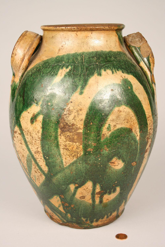 This 19th-century redware jar, made in the workshop of East Tennessee potter Christopher Haun, will be offered in the Oct. 16 sale at Case Auctions in Knoxville. Dramatic streaks of green copper oxide decorate the curve of the body. Image courtesy Case Auctions, Knoxville, Tenn.