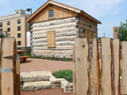 Among the many educational exhibits at the Madison Children's Museum is an authentically restored, late-1830s log home typical of the size and type built by Madison's earliest European settlers. The cabin was recovered from a Walworth County homestead with help from the Nature Conservancy and professionally restored on a corner of the museum's parking lot. Image courtesy of Madison Children's Museum.