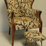 This attractive crewel-upholstered French-style chair with ottoman has an opening bid of only $70 in Ivy Auctions' Aug. 28 sale. Image courtesy LiveAuctioneers.com and Ivy Auctions.