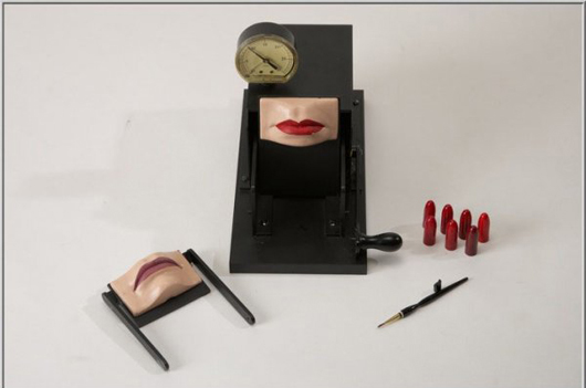 """Another bizarre device from the Max Factor Collection is this """"Kissing Machine,"""" which was also used for Red Hot Chili Peppers' Greatest Hits album cover in 2003. With noted damage, the Kissing Machine has a $25,000-$55,000 estimate. Image courtesy of Super Auctions."""