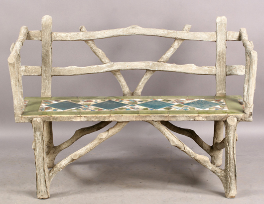 The cast stone faux bois bench features a seat inlaid with colorful tiles. The lot brought $570 in June. Image courtesy of Kamelot Auctions.