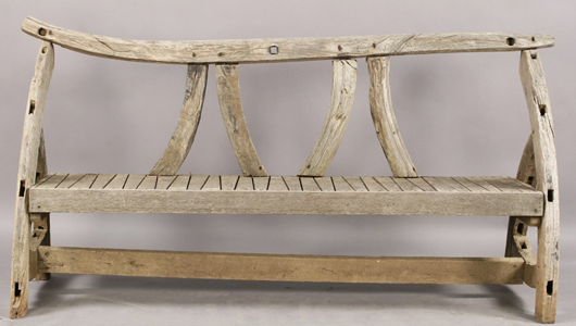 A charming wooden bench with silvery patina brought $1,320 in Kamelot's April garden antiques sale. Image courtesy of Kamelot Auctions.