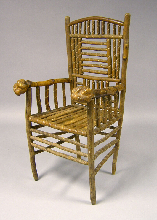 A whimsical early 20th-century Adirondack chair features spiral turnings and chunky root arms. The folk art seating brought $556 at a 2007 Pook & Pook auction sale. Image courtesy of Pook & Pook Inc.