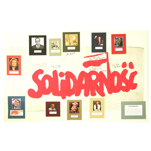 Solidarity banner, marking the end of Communism and signed by world leaders involved. Image courtesy of Signature House.