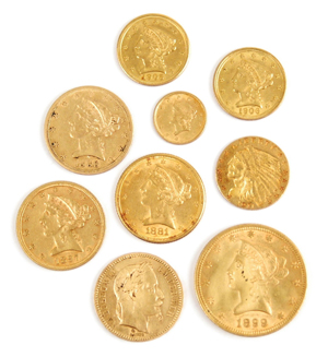 Nineteenth-century gold coins of various denominations were found in the suitcases. An 1899 $10 gold piece (lower right) sold for $660. Stephenson's Auctions image.
