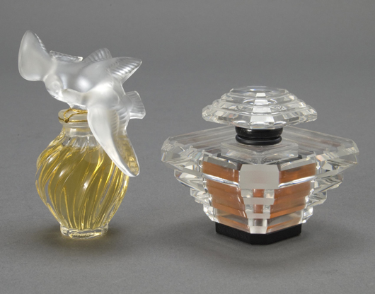 Two Lalique France perfume bottles: Tresor and L'Air du Temps. Estimate: $600-$800. Image courtesy of Michaan's Auctions.