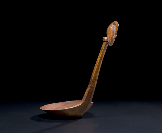 Iroquois figural burl feast ladle (est. $15,000-$20,000). Image courtesy of Cowan's Auctions Inc.