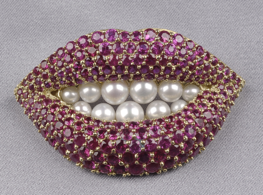 Designed by Salvador Dali and executed by jeweler Henry Kaston, this 18-karat gold 'Lips' brooch sold for $13,035 earlier this year. Noting that poets dream about ruby lips and teeth like pearls, Dali turned the fantasy into reality. Image courtesy of Skinner Inc.