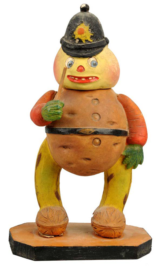 Halloween veggie man candy container with bobby's hat, 9½ inches tall, estimate $3,000-$5,000. Dan Morphy Auctions image.