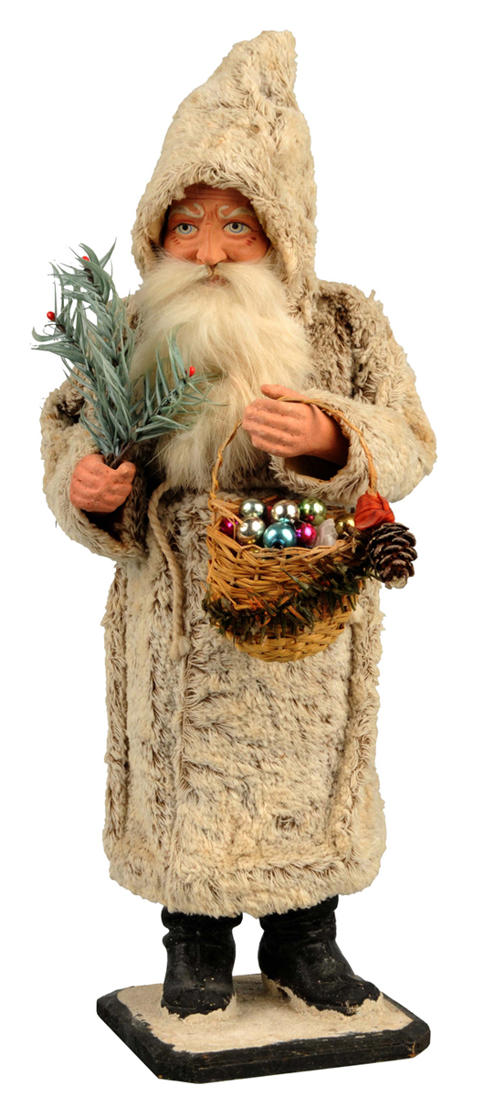 Rare Christmas candy container of Santa holding fir tree and carrying basket of ornaments, 15 inches tall, estimate $3,000-$5,000. Dan Morphy Auctions image.