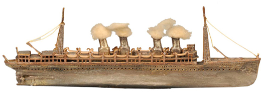 Dresden Christmas ornament replicating a battleship with four smokestacks, highly detailed, estimate $4,000-$6,000. Dan Morphy Auctions image.
