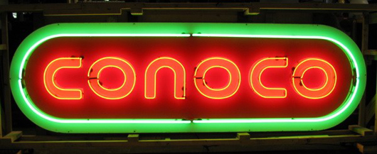 Oversized original Conoco brand oval porcelain advertising sign, remade with neon, 36 inches high by 118 inches wide, est. $2,500-$4,000. Image courtesy of Great Gatsby's Auction Gallery.