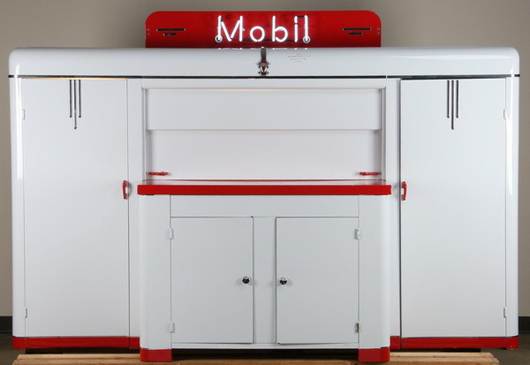 Rare Art Deco service station mechanic's work station by the Lincoln Engineering Co., with neon Mobil brand logo sign, circa 1940s, 60 inches high by 98 inches long by 26 inches deep, est. $15,000-$25,000. Image courtesy of Great Gatsby's Auction Gallery.