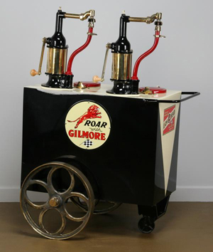 This Bennett double pump curbside lubester with dispensers to accommodate SAE 20 and SAE 30 motor oils is considered rare. It bears the 'Roar With Gilmore Motor Oil' brand logo. It has a $4,000-$6,000. Image courtesy of Great Gatsby's Auction Gallery.