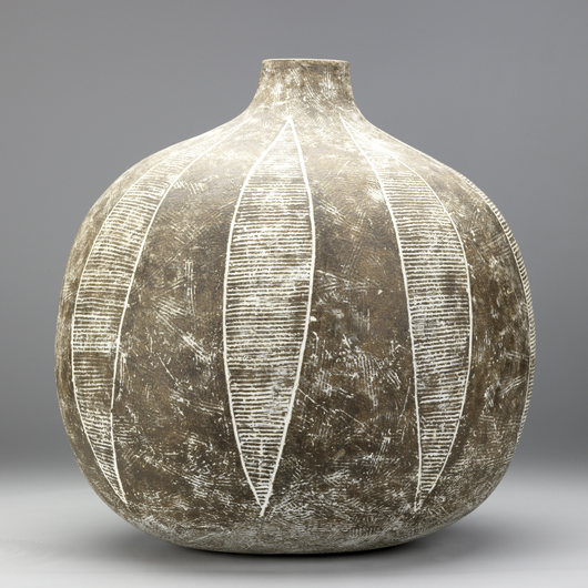 An early work titled 'Colima' sold last year at Rago Arts for $18,300. Leaf-like designs accent the curve of the body. Image courtesy of Rago Arts and Auction Center.