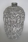 Conover's 'Hoopeb' vase is decorated at the shoulder with circles and crenellations in relief; the vessel sold in October 2009 for $6,500. Image courtesy of Rachel Davis Auctions.