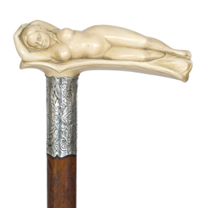 A full-figured beauty graces the handle of this French Art Nouveau erotic cane, which has a $3,000-$6,000 estimate. Image courtesy of Kimball M. Sterling Inc.