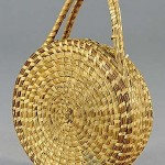 This Southern sweetgrass basket with hinged lid and elongated handle dates to the early 1900s. Image courtesy of Charlton Hall Galleries Inc. and LiveAuctioneers archive.