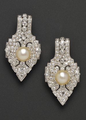 These antique platinum brooches are set two large pearls, each over 9 mm, surrounded by diamonds. The dazzling pair sold in Skinner's Sept. 14 Fine Jewelry sale for $13,035. Image courtesy of Skinner Inc.