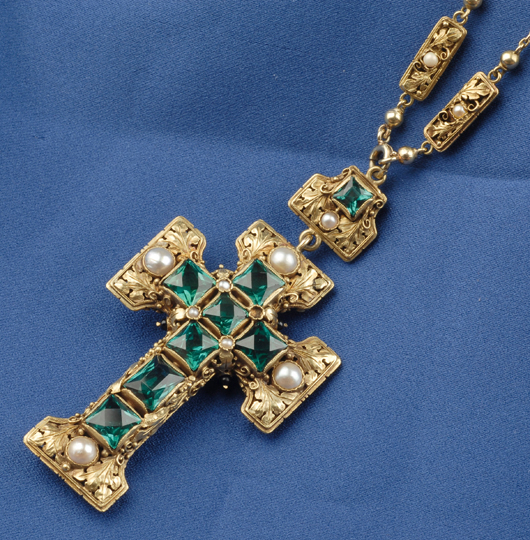 American Arts & Crafts metalworker Edward Oakes often used pearls in his jewelry designs. This gold cross by set with vivid green tourmalines and pearls brought a strong $34,075 in 2007. Image courtesy of Skinner Inc.