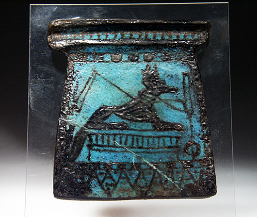 Pectorals placed around the neck of mummies were usually decorated with images of funerary gods and regeneration symbols, as is the case on this specimen of glazed faience. This New Kingdom or shortly later piece is about 3 1/2 inches high. It has a $7,000-$8,000 estimate. Image courtesy of Artemis Gallery Live.com.