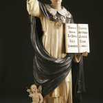 St. Thomas Aquinas is depicted in a circa 1920 polychrome plaster statue, which has glass eyes. The three-quarter life-size figure sold for $500 at an auction in 2007. Image courtesy of Jackson's International Auctioneers & Appraisers and LiveAuctioneers archive.