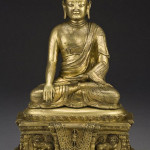 Chinese Qing gilt bronze shakyamuni Buddha seated on a throne, hands in Buddhist mudra, 14 1/2 inches high. Estimate: $20,000- $40,000. Image courtesy of Dallas Auction Gallery.