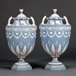 Pair of Wedgwood solid blue jasper tea urns and covers, late 18th century, each with applied white foliate and floral designs, impressed marks, height 18 inches, est. $15,000-$25,000. Image courtesy of Skinner Inc.
