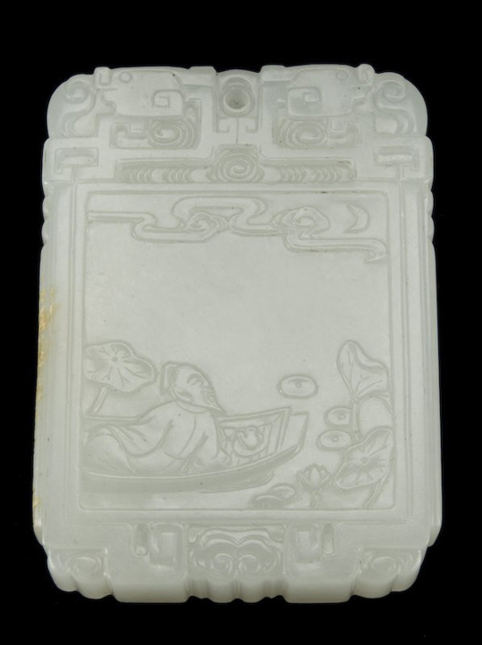 White jade pendant signed Zigang, carved to depict Li Bai on a boat, having a poem on the verso, 18th century, 2 1/4 inches high by 1 1/2 inches wide. Estimate:  $18,000- $24,000. Image courtesy of Dallas Auction Gallery.