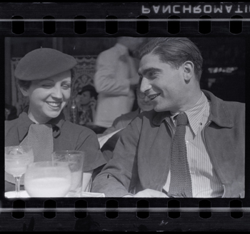 Fred Stein [Gerda Taro and Robert Capa on the Terrace of Cafe du Dome in Montparnasse, Paris], early 1936. Negative. Copyright Estate of Fred Stein, International Center of Photography.