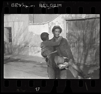 Robert Capa [Man carrying a wounded boy, Teruel, spain], late December 1937 Negative. Copyright International Center of Photography / Magnum Collection, International Center of Photography.