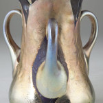 The top lot of the sale was this Tiffany & Co. Favrille glass three-handled vase, which sold for $62,100. Photo courtesy of Leland Little Auction & Estate Sales Ltd.