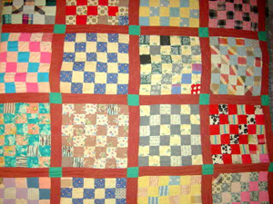Approximately 16 handmade quilts, including this nice checkerboard square example, will be sold. Image courtesy of Specialists of the South Inc.